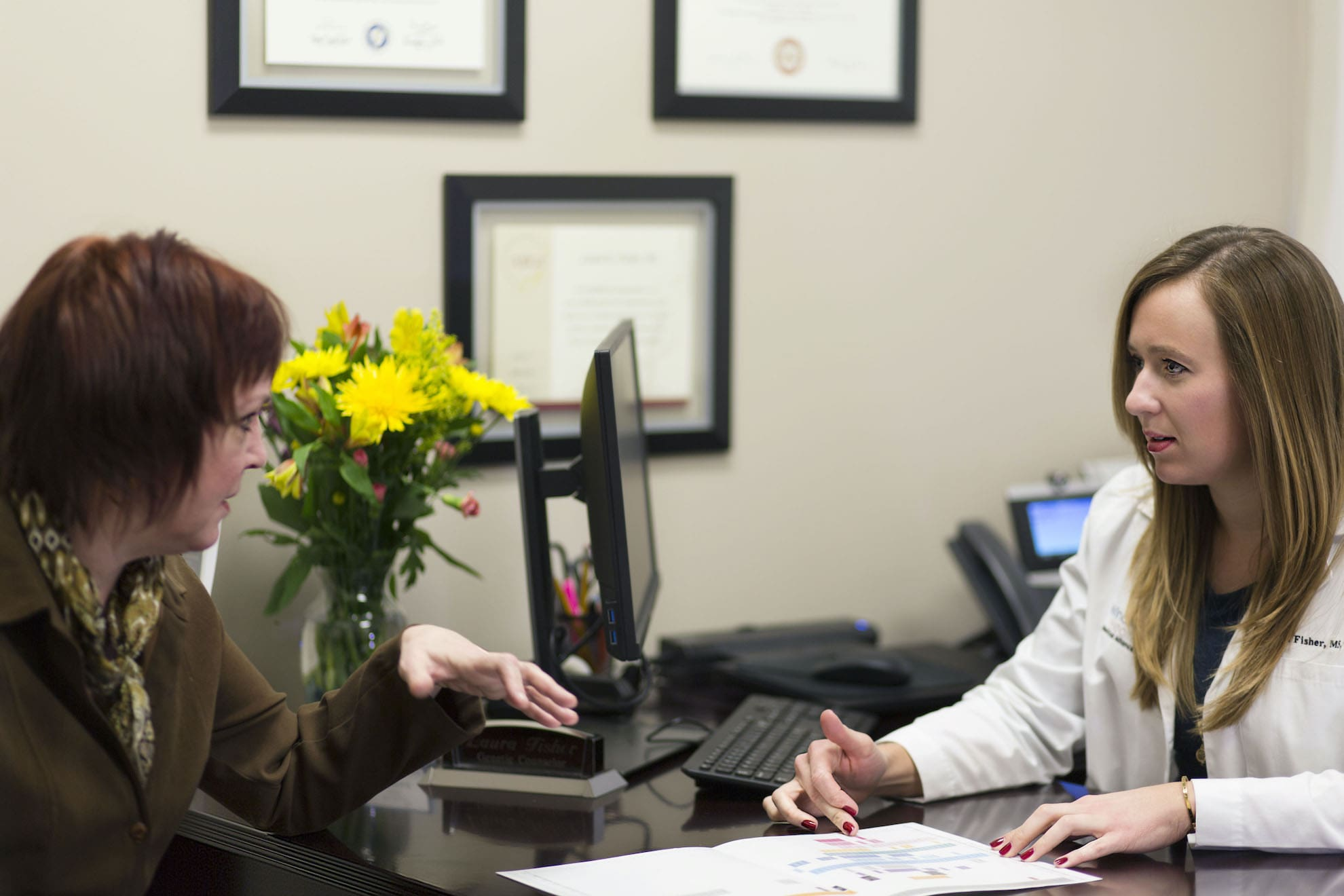 Genetic Counselor Laura Fisher with Patient